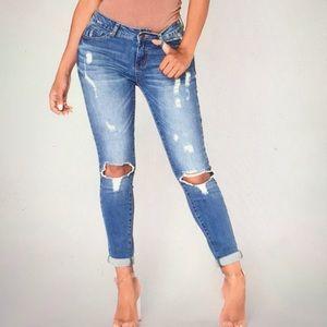 Fashion Nova Distressed Mid Rise Skinny Jeans